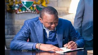 President Uhuru Kenyatta signs bill into law