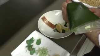 Kris De Roy prepares a sea bass dish at Hofke Van Bazel in Belgium