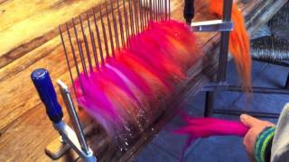 Making your own roving with a hackle and diz(This is a short video made to accompany a mini tutorial newsletter! Demonstrating how simple it is to use a hackle to blend colours and add sparkle to make your ..., 2013-04-01T22:39:17.000Z)