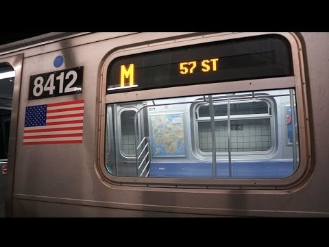 57 Street - 6 avenue Bound R160 M train entering 14 Street