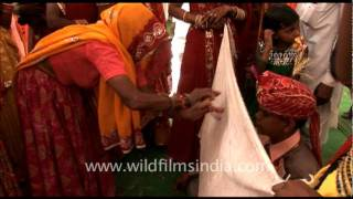 Wedding rituals and folk songs, in rural India.