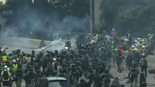 Tear gas fired as Hong Kong police, protesters clash | AFP
