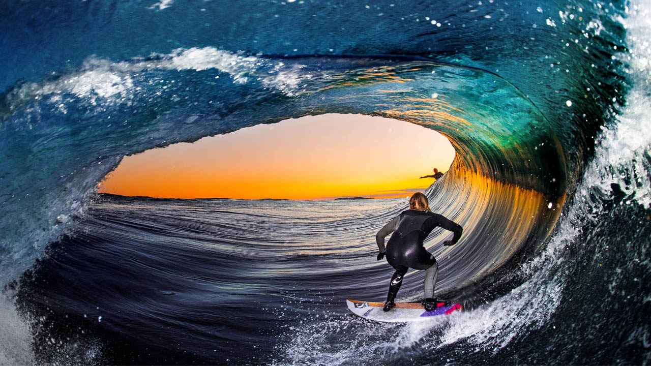 Surfers From Inside Barrel Of Wave