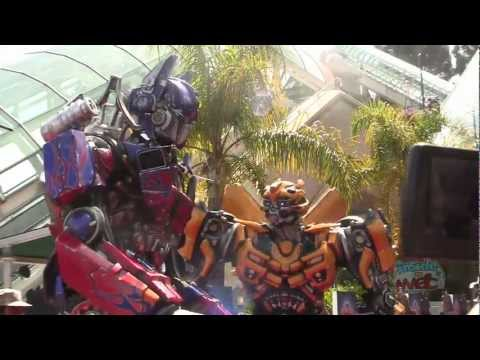 Optimus Prime & Bumblebee As Vehicles And Robots At Transformers: The Ride 3D Grand Opening