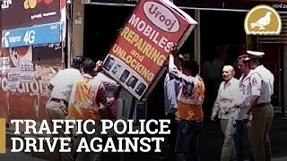 Traffic police remove sign boards in Nampally