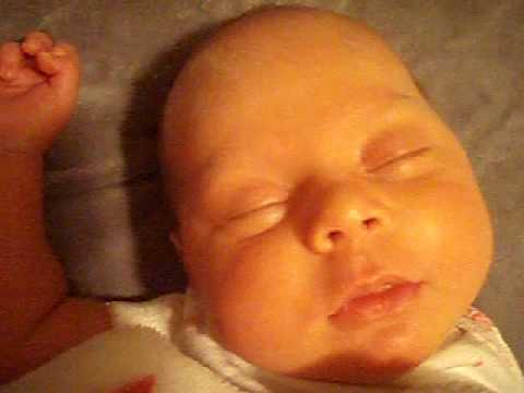 Baby Kira 1 month old eyes rolling in REM sleep