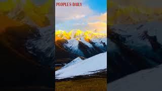 The sunrise dyes the snow-capped Minya Konka