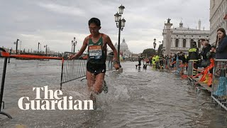 Marathon runners race through Venice's flooded streets