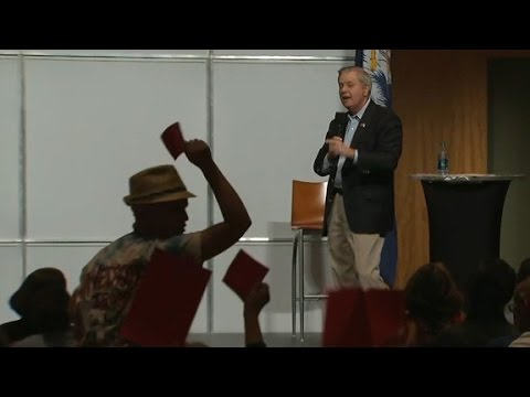 Town hall crowd chants at Graham