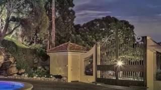 Large wood gates designs ideas. Mulholland Security. Gates