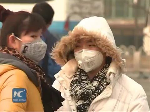 Heavy smog shrouds Beijing and over 30 cities in north China