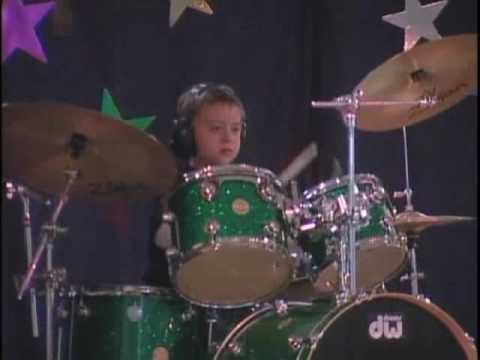 9 year old Harry Strunk plays Wipeout on drums live at his 3rd grade variety show.