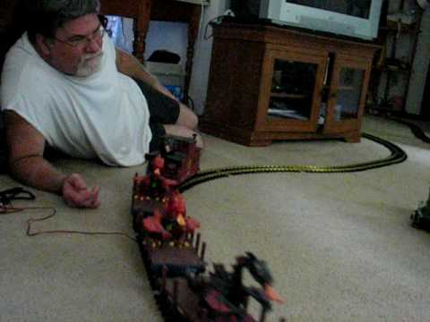playing with g scale train in the living room