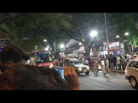 RCB team bus entering Chinnaswamy Stadium - Virat Kohli in the front seat