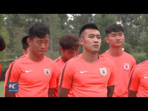 Chinese soccer players arrive in Argentina for training