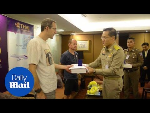 British cave rescue heroes arrive in Bangkok to applause - Daily Mail