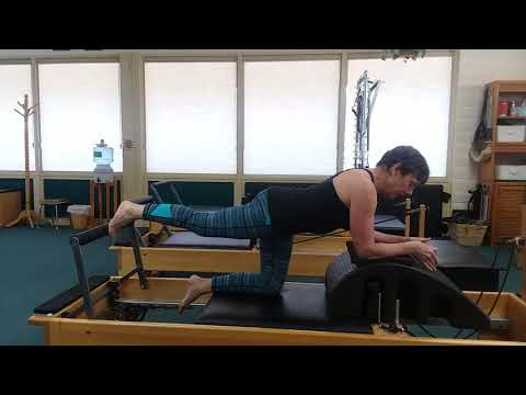 Pilates arc on the reformer series - 3. Kneeling Hip Extension - facing away from the foot bar