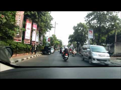 Kemang, Jakarta, Indonesia - driving on the main road