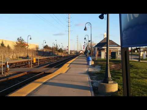 Metra MP36-3S 415 pulls outbound rush hour train number 115 through Round Lake Beach on 4/11/16