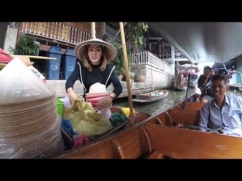 Beautiful Lady sells Hat Thailand Damnoen Saduak Floating Market Part.6 outside Bangkok YN110799