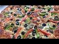 طريقة عمل البيتزا طريقة عمل بيتزا بجبنة الموزريلا بطريقة احترافية ولذيذة المذاق فيديو من يوتيوب
