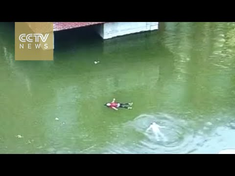 Footage: Children saved from pond after struggling for two minutes in water