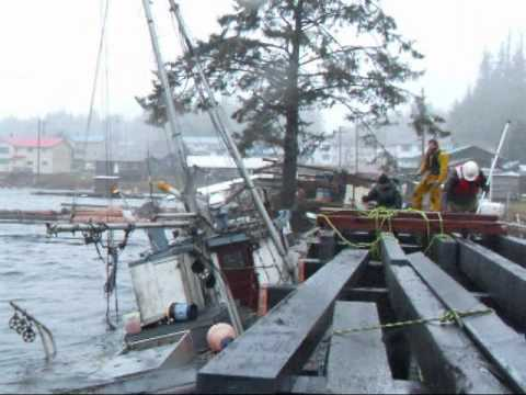 Sea 2 Stone Marine Crew going to work in a storm. Kyuquot, Vancouver Island, British Columbia.