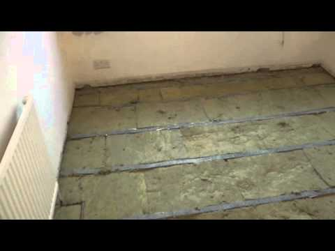 Snug Ing Soundproofing Material Laid Between Floor Joists Prior To Accoustalay