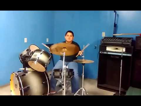 Rigoberto Zuñiga uses drums