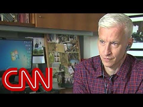 Anderson Cooper attempting to go about his daily routine while under the influence of a simulation designed to replicate the experience of someone suffering with schizophrenia -