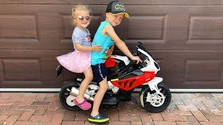 Little Girl Elis Ride On BMW Motorbike with Thomas Outdoor Activity