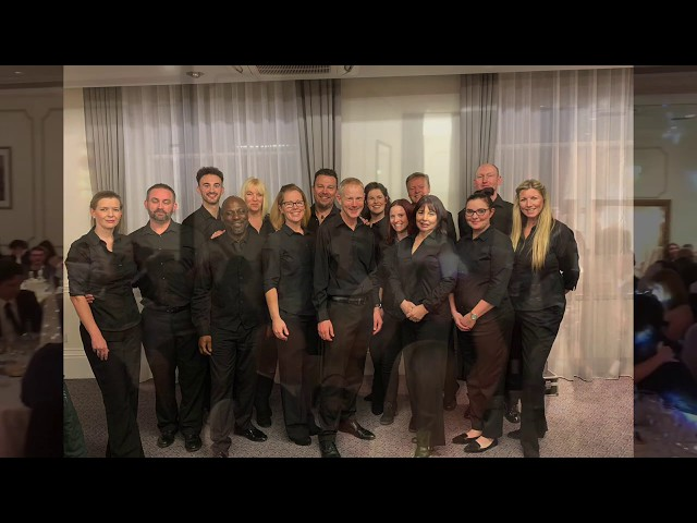 14 Singing Waiters at the Grand