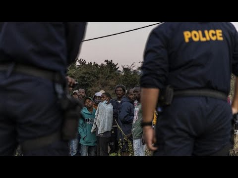 South African police and soldiers confiscate looted items