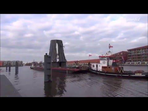 Transport molen De Haan per boot in Nauerna gearriveerd