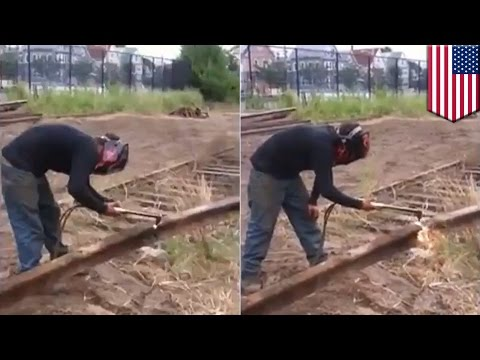 Man vs train tracks: Rail worker cutting through train tracks is about to experience pain - TomoNews