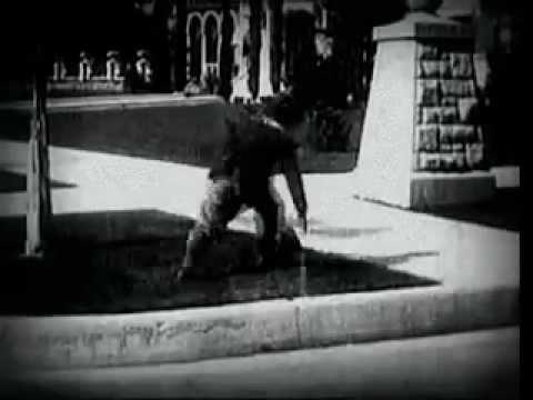 Charlie Chaplin: Between Showers (1914)