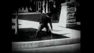 Charlie Chaplin: Between Showers (1914)