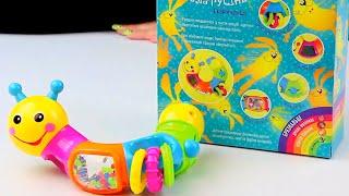 Обзор - распаковка игрушек Погремушка Гусеница-ломалка в коробке Арт: KI-904