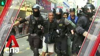 Hong Kong protests: Police make arrests as rallies erupt across city, shops vandalised