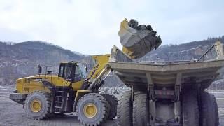 Komatsu WA500-7 loads HD605 Dump Truck in a quarry