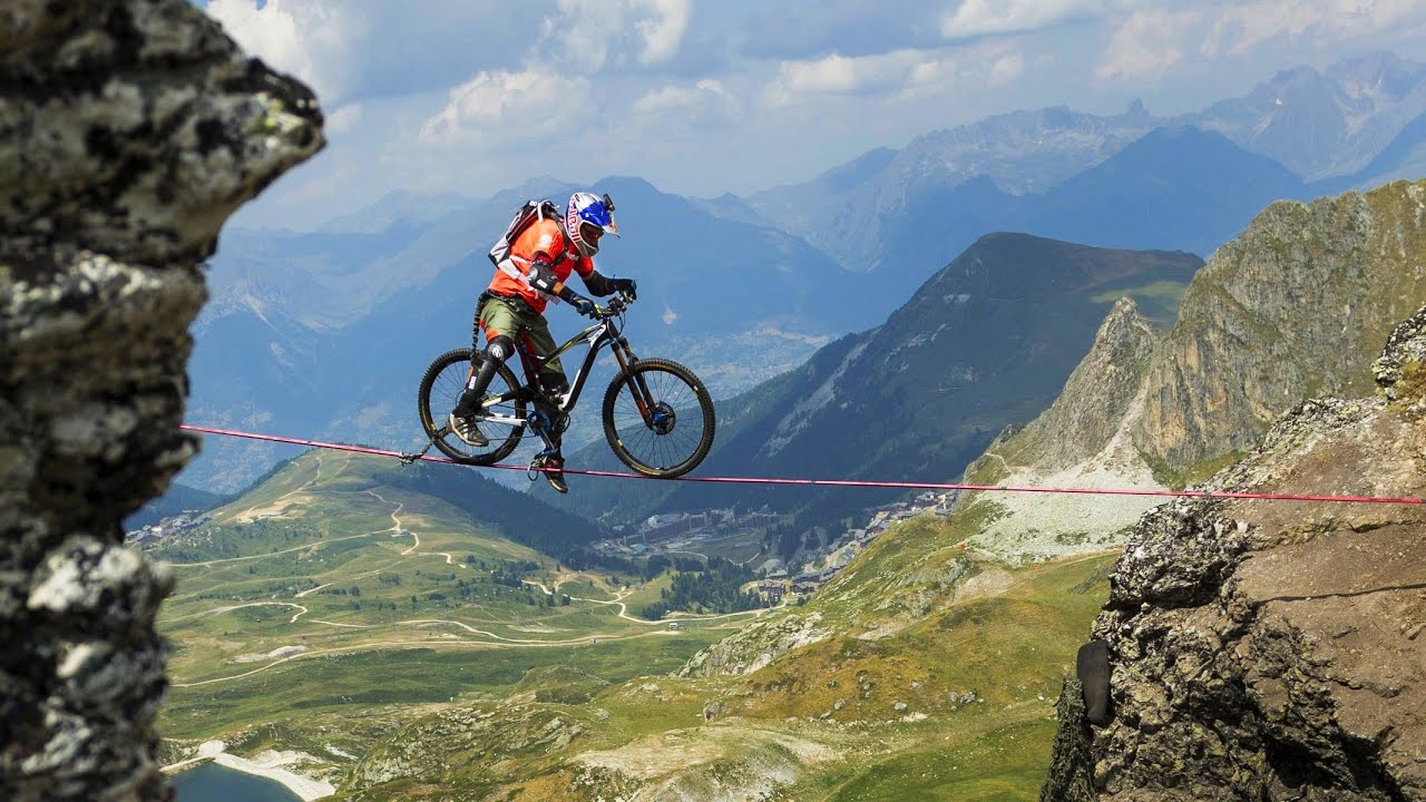 Kenny Belaey rides a slackline over a 112m drop in the French Alps at an altitude of 2700m