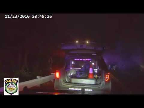 Video captured from one of the police vehicles' on-board camera systems of a rescue from a burning Range Rover on Thanksgiving Eve.