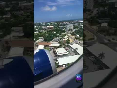 Flight and landing over ocean and grand cayman island