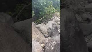 Lerato Monyatsi hiking Champagne Castle in Drakensberg Mountains. Mrs Bear Grylls looking for water