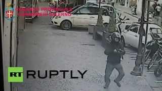 Italy: Watch man fire MACHINE GUN into crowd