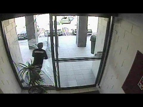 Grab And Smash Bag Thief Runs Through Glass Door No Comment Youtube