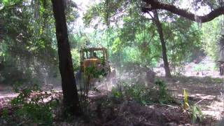 clearing land with a loader
