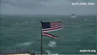 US flag ripped by Hurricane Florence while flying above Frying Pan Tower at Outer Banks