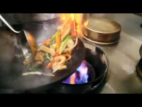flipping fresh vegetables in hot wok slow motion Royalty Free Stock Footage, Full HD