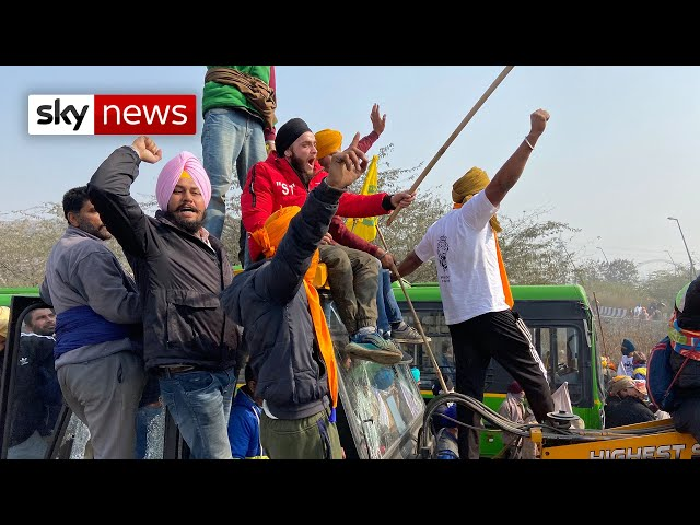 India: Tear gas fired as farmers clash with police in Delhi